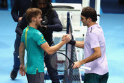 David Goffin of Belgium shakes hands at the net after his three set victory against Roger Federer of Switzerland in their semi final match the Nitto ATP World Tour Finals at O2 Arena on November 18, 2017 in London, England.