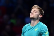 Belgium's David Goffin celebrates beating Switzerland's Roger Federer during their men's singles semi-final match on day seven of the ATP World Tour Finals tennis tournament at the O2 Arena in London on November 18, 2017..David Goffin won 2-6, 6-3, 6-4.  / AFP PHOTO / Glyn KIRK