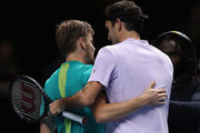 David Goffin of Belgium is congratulated by Roger Federer of Switzerland in the semi finals during day seven of the Nitto ATP World Tour Finals tennis at the O2 Arena on November 18, 2017 in London, England.