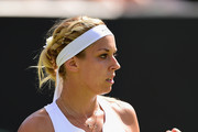 Sabine Lisicki of Germany celebrates winning a point in her LadiesÂ' Singles Third Round match against Timea Bacsinszky of Switzerland during day six of the Wimbledon Lawn Tennis Championships at the All England Lawn Tennis and Croquet Club on July 4, 2015 in London, England.