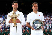 Novak Djokovic of Serbia and Roger Federer of Switzerland pose for a photo with their trophies after the Men's Singles final during Day thirteen of The Championships - Wimbledon 2019 at All England Lawn Tennis and Croquet Club on July 14, 2019 in London, England.