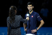 Novak Djokovic of Serbia speaks with Annabel Croft on court following his victory in his men's singles match against Milos Raonic of Canada on day three of the ATP World Tour Finals at O2 Arena on November 15, 2016 in London, England.