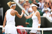 Lucie Safarova of Poland (L) shakes hands with Agnieszka Radwanska of Poland after their Ladies' Singles second round match on day three of the Wimbledon Lawn Tennis Championships at All England Lawn Tennis and Croquet Club on July 4, 2018 in London, England.