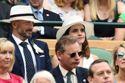 John Vosler and Emma Watson attend day twelve of the Wimbledon Lawn Tennis Championships at All England Lawn Tennis and Croquet Club on July 14, 2018 in London, England.