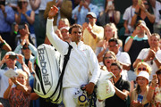 Rafael Nadal of Spain waves to his fans as he leaves Centre Court after winning his Men's Singles first round match against Dudi Sela of Isreal on day two of the Wimbledon Lawn Tennis Championships at All England Lawn Tennis and Croquet Club on July 3, 2018 in London, England.