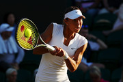 Vitalia Diatchenko of Russia returns against Maria Sharapova of Russia during their Ladies' Singles first round match on day two of the Wimbledon Lawn Tennis Championships at All England Lawn Tennis and Croquet Club on July 3, 2018 in London, England.