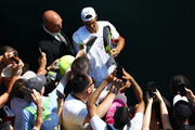 Rafael Nadal of Spain (C) signs autographs for fans after his warm up session on day two of the Wimbledon Lawn Tennis Championships at All England Lawn Tennis and Croquet Club on July 3, 2018 in London, England.