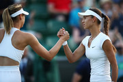 Vitalia Diatchenko of Russia (R) shakes hands with Maria Sharapova of Russia after their Ladies' Singles first round match on day two of the Wimbledon Lawn Tennis Championships at All England Lawn Tennis and Croquet Club on July 3, 2018 in London, England.