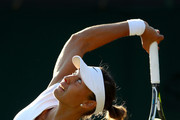 Vitalia Diatchenko of Russia serves against Maria Sharapova of Russia during their Ladies' Singles first round match on day two of the Wimbledon Lawn Tennis Championships at All England Lawn Tennis and Croquet Club on July 3, 2018 in London, England.