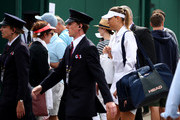 Maria Sharapova of Russia makes her way to the court prior to her Ladies' Singles first round match against Pauline Parmentier of France during Day two of The Championships - Wimbledon 2019 at All England Lawn Tennis and Croquet Club on July 02, 2019 in London, England.