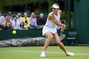 Andrea Petkovic of Germany plays a backhand in her Ladies' Singles first round match against Monica Niculescu of Romania during Day two of The Championships - Wimbledon 2019 at All England Lawn Tennis and Croquet Club on July 02, 2019 in London, England.