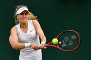 Eugenie Bouchard of Canada plays a backhand in her Ladies' Singles first round match against Tamara Zidansek of Slovenia during Day two of The Championships - Wimbledon 2019 at All England Lawn Tennis and Croquet Club on July 02, 2019 in London, England.