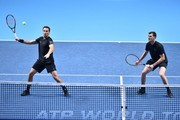 Britain's Jamie Murray (R) stands ready as his partner Brazil's Bruno Soares (L) returns against USA's Bob Bryan and USA's Mike Bryan during their men's doubles match on day two of the ATP World Tour Finals tennis tournament at the O2 Arena in London on November 13, 2017. / AFP PHOTO / Glyn KIRK