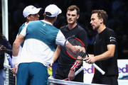 Bob and Mike Bryan of the United States shake hands with Jamie Murray of Great Britain and Bruno Soares (R) of Brazil after their Doubles match during day two of the Nitto ATP World Tour Finals at O2 Arena on November 13, 2017 in London, England.