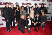 "(Back row L-R) Simon Kinberg, Paul Wernick, Morena Baccarin, Leslie Ugghams, Ryan Reynolds, Brianna Hildebrand, Ed Skrein, Stefan Kapicic, (front row L-R) Tim Miller, Rhett Reese, Rob Liefeld and Greg LaSalle attend the ""Deadpool"" fan event at AMC Empire Theatre on February 8, 2016 in New York City."