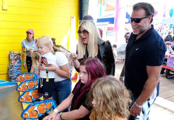 UCLA Mattel Children's Hospital's 20th Annual 'Party On The Pier' [hair,yellow,product,hairstyle,fun,fashion,event,child,eyewear,blond,party on the pier,ucla mattel childrens hospital,santa monica pier,california,pacific park,tori spelling,dean mcdermott]