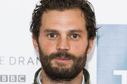 Jamie Dornan attends a photocall for 'Death and Nightingales' at Soho Hotel on November 26, 2018 in London, England.