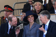 Britain's Prince William, Duke of Cambridge, (front row, L), Britain's Catherine, Duchess of Cambridge, (front row, centre) and British Chancellor of the Exchequer Philip Hammond (front row, R) chat as they attend a Service of Commemoration and Drumhead Service on Horse Guards Parade in central London on March 9, 2017, which honours the service and duty of both the UK Armed Forces and civilians in the Gulf region, Iraq and Afghanistan, and those who supported them back home, from 1990-2015..After the Drumhead Service, The Queen will officially unveil The Iraq and Afghanistan memorial. / AFP PHOTO / Justin TALLIS