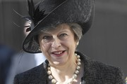 British Prime Minister Theresa May arrives for the unveiling of the new memorial to members of the armed services who served and died in the wars in Iraq and Afghanistan at Victoria Embankment Gardens on March 8, 2017 in London, England.
