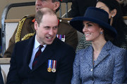 Britain's Catherine, Duchess of Cambridge (R) smiles a she talks to Britain's Prince William, Duke of Cambridge (L) as they attend a Service of Commemoration and Drumhead Service on Horse Guards Parade in central London on March 9, 2017, which honours the service and duty of both the UK Armed Forces and civilians in the Gulf region, Iraq and Afghanistan, and those who supported them back home, from 1990-2015..After the Drumhead Service, The Queen will officially unveil The Iraq and Afghanistan memorial. / AFP PHOTO / Justin TALLIS