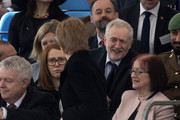 Britain's opposition Labour Party Leader Jeremy Corbyn (centre R) speaks to SNP leader Nicola Sturgeon (C) as they attend a Service of Commemoration and Drumhead Service on Horse Guards Parade in central London on March 9, 2017, which honours the service and duty of both the UK Armed Forces and civilians in the Gulf region, Iraq and Afghanistan, and those who supported them back home, from 1990-2015..After the Drumhead Service, The Queen will officially unveil The Iraq and Afghanistan memorial. / AFP PHOTO / Justin TALLIS