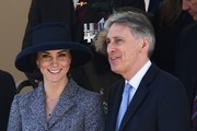 Britain's Catherine, Duchess of Cambridge (L) smiles a she talks to British Chancellor of the Exchequer Philip Hammond (R) as they attend a Service of Commemoration and Drumhead Service on Horse Guards Parade in central London on March 9, 2017, which honours the service and duty of both the UK Armed Forces and civilians in the Gulf region, Iraq and Afghanistan, and those who supported them back home, from 1990-2015..After the Drumhead Service, The Queen will officially unveil The Iraq and Afghanistan memorial. / AFP PHOTO / Justin TALLIS