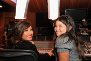 Actress/singer Demi Lovato and sister actress Madison De La Garza attend a Live Chat at Cambio Studios on July 21, 2011 in Hollywood, California.
