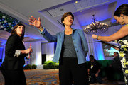 Democratic candidate for Florida Governor Alex Sink (C) waves to supporters before the beginning of her election night party during midterm elections on November 2, 2010 in Tampa, Florida. Sink is up against Republican gubernatorial candidate Rick Scott to fill the slot currently held by Florida Gov. Charlie Crist who is running for U.S. Senate.