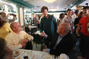 Democratic gubernatorial candidate Alex Sink (C) greets people during a campaign stop at Versailles restaurant October 29, 2010 in Miami, Florida. Sink is facing off against Republican challenger Rick Scott for the Florida governor's seat.