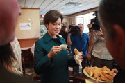 Democratic gubernatorial candidate Alex Sink drinks a cafecito and eats a pastelito during a campaign stop at the Cuban Versailles restaurant October 29, 2010 in Miami, Florida. Sink is facing off against Republican challenger Rick Scott for the Florida governor's seat.