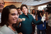 Democratic gubernatorial candidate Alex Sink (C) drinks a cafecito and eats a pastelito during a campaign stop at the Cuban Versailles restaurant October 29, 2010 in Miami, Florida. Sink is facing off against Republican challenger Rick Scott for the Florida governor's seat.