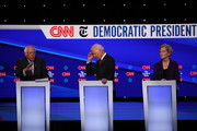 (L-R) Sen. Bernie Sanders (I-VT), former Vice President Joe Biden, and Sen. Elizabeth Warren (D-MA) react during the Democratic Presidential Debate at Otterbein University on October 15, 2019 in Westerville, Ohio. A record 12 presidential hopefuls are participating in the debate hosted by CNN and The New York Times.