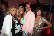 Joan Collins and Denise Rich Photos Photo