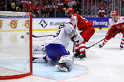 Frans Nielsen #51 of Denmark tries to core over Henrik Haukeland, goaltender of Norway during the 2018 IIHF Ice Hockey World Championship Group B game between Denmark and Norway at Jyske Bank Boxen on May 11, 2018 in Herning, Denmark.