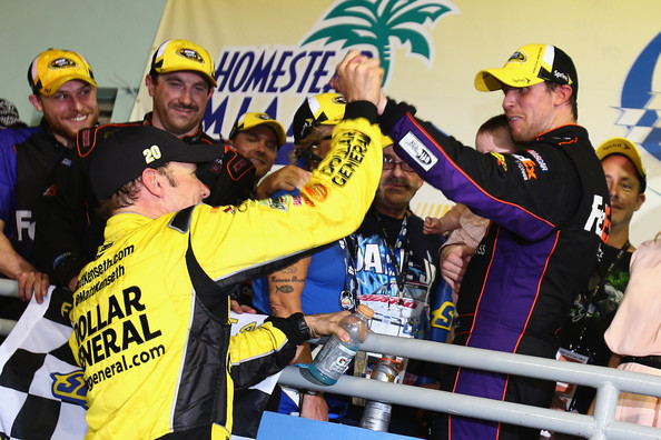 Teammate Matt Kenseth congratulates winner Denny Hamlin