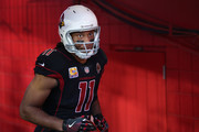 Wide receiver Larry Fitzgerald #11 of the Arizona Cardinals runs out onto the field before the NFL game against the Denver Broncos at State Farm Stadium on October 18, 2018 in Glendale, Arizona.