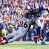 Mike Tolbert Photos - Darian Stewart #26 of the Denver Broncos attempts to tackle Mike Tolbert #35 of the Buffalo Bills during an NFL game on September 24, 2017 at New Era Field in Orchard Park, New York. - Denver Broncos vBuffalo Bills