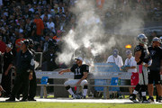 Sebastian Janikowski #11 of the Oakland Raiders rests on the sidelines after three missed field goals against the Denver Broncos at O.co Coliseum on October 11, 2015 in Oakland, California.