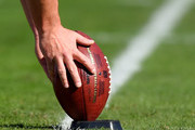 A detailed view of kicker Sebastian Janikowski #11 of the Oakland Raiders placing an NFL football on a kicking T during warm ups prior to playing the Denver Broncos at O.co Coliseum on November 9, 2014 in Oakland, California.