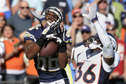 Vincent Brown #86 of the San Diego Chargers drops a touchdown pass in the end zone as he is defended by Kayvon Webster #36 of the Denver Broncos during the football game at Qualcomm Stadium November 10, 2013 in San Diego, California.