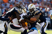 Jahleel Addae #37 of the San Diego Chargers and  Manti Te'o #50 of the San Diego Chargers tackle  Demaryius Thomas #88 of the Denver Broncos during the first quarter of a game at Qualcomm Stadium on December 6, 2015 in San Diego, California.