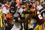 Wide receiver Demaryius Thomas #88 of the Denver Broncos rushes past Josh Norman #24 of the Washington Redskins in the first half during a preseason game at FedExField on August 24, 2018 in Landover, Maryland.
