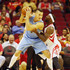Ty Lawson Danilo Gallinari Photos - Danilo Gallinari #8 of the Denver Nuggets drives with the basketball against Ty Lawson #3 of the Houston Rockets during their game at the Toyota Center on October 28, 2015 in Houston, Texas. - Denver Nuggets v Houston Rockets