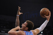 Blake Griffin #32 of the Los Angeles Clippers is fouled as he attempts a dunk by Kenneth Faried #35 of the Denver Nuggets during the first half at Staples Center on February 22, 2012 in Los Angeles, California.  NOTE TO USER: User expressly acknowledges and agrees that, by downloading and or using this photograph, User is consenting to the terms and conditions of the Getty Images License Agreement.
