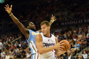 Blake Griffin #32 of the Los Angeles Clippers grabs a rebound against Kenneth Faried #35 of the Denver Nuggets during their preseason game at the Mandalay Bay Events Center on October 18, 2014 in Las Vegas, Nevada. NOTE TO USER: User expressly acknowledges and agrees that, by downloading and or using this photograph, User is consenting to the terms and conditions of the Getty Images License Agreement.