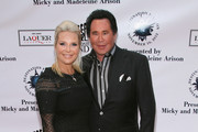 Singer Wayne Newton (R) and wife Kathleen McCrone attend Destination Fashion 2012 To Benefit The Buoniconti Fund To Cure Paralysis, the fundraising arm of The Miami Project to Cure Paralysis, on November 10, 2012 in Miami, Florida.