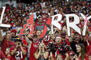 Cardinals fans hold up letters in support of Larry Fitzgerald #11 of the Arizona Cardinals during the second half of the NFL football game against of the Detroit Lions at State Farm Stadium on September 08, 2019 in Glendale, Arizona.
