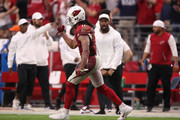 Wide receiver Larry Fitzgerald #11 of the Arizona Cardinals reacts after a 45 yard reception past against the Detroit Lions during overtime of the NFL game at State Farm Stadium on September 08, 2019 in Glendale, Arizona. The Lions and Cardinals tied 27-27.