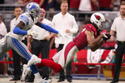 Wide receiver Larry Fitzgerald #11 of the Arizona Cardinals makes a 45 yard reception past defensive back Tracy Walker #21 of the Detroit Lions during overtime of the NFL game at State Farm Stadium on September 08, 2019 in Glendale, Arizona. The Lions and Cardinals tied 27-27.