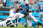 Reggie Bush #21 of the Detroit Lions runs the ball against the Carolina Panthers during their game at Bank of America Stadium on September 14, 2014 in Charlotte, North Carolina.